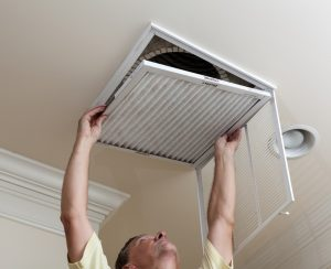 technician-changing-filter-vent