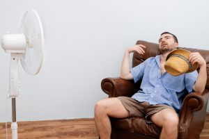 man-in-front-of-fan
